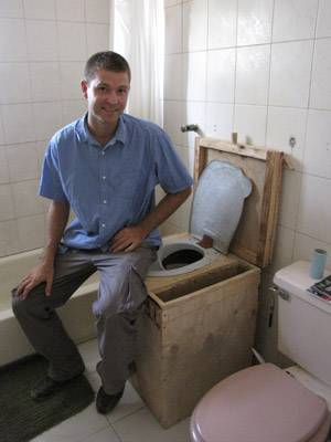 Nick Preneta demonstrates a SOIL EcoSan household toilet.