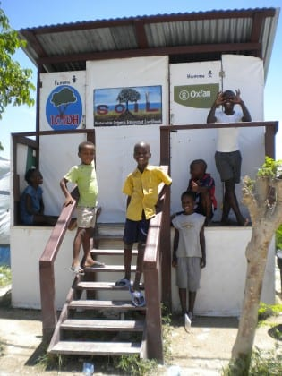 Children in the Nazon community of Port-au-Prince on the steps of a SOIL emergency toilet.