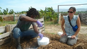 Rebecca training SOIL's own Jimmy Louis in gas sampling at the Port-au-Prince compost site.