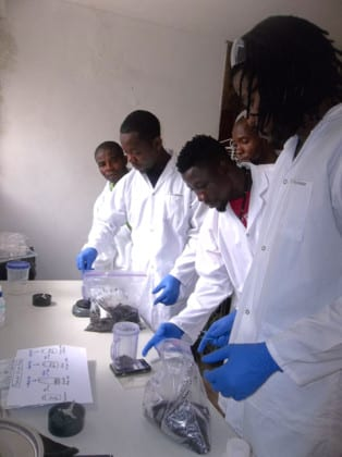 The Port-au-Prince team examines samples in our new lab!