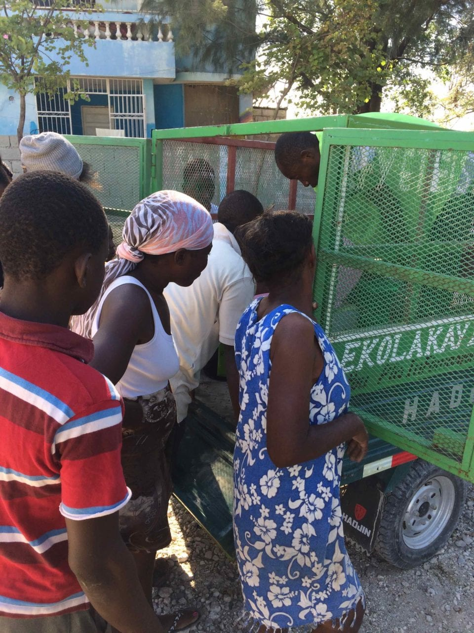 Jean Nelson's neighbors check out an EkoLakay toilet just before it's installed